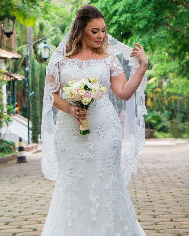 3ef9b3ab38c This slightly off the shoulder plus size wedding dress hass short cap  sleeves. Fuller figured brides searching for custom  plussizeweddingdresses  will like ...