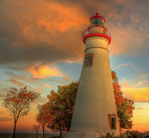 """Marked as """"autumn lighthouse"""" I'd recognize this lighthouse anywhere. I recognize those rocks and those trees.  It's the Marblehead lighthouse on Lake Erie.  -Audrey"""