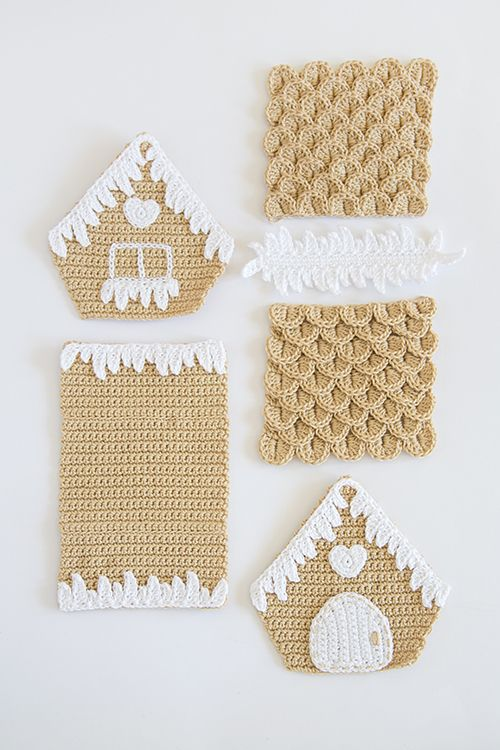 Photo of beautiful gingerbread house. Crochet pattern by Ilaria Caliri can be found in th…