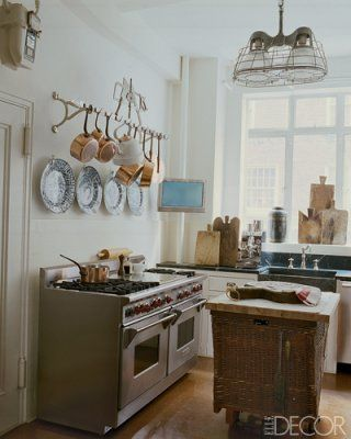 Copper Cookware Hangs From Antique Butcheru0027s Rack ; The Light Fixture Is A  Vintage Factory Piece. Antique French Cutting Boards Lean Against A Window  Elle ...