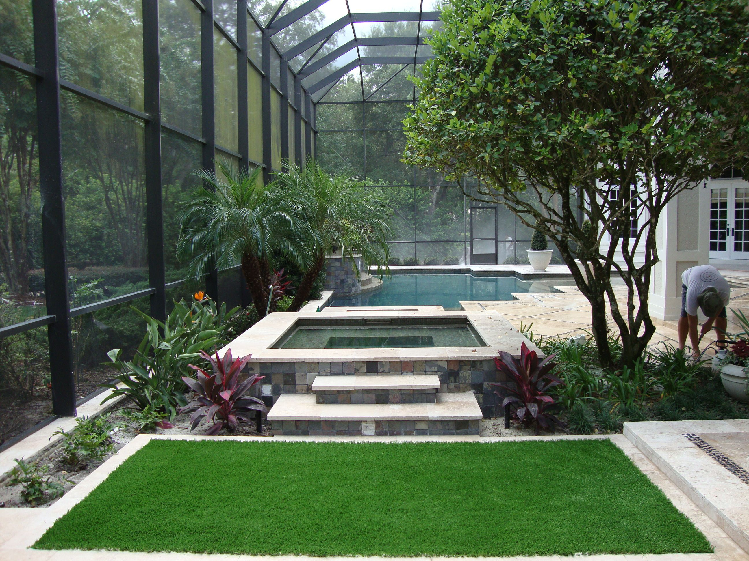 When Installed On Your Back Patio Inside Your Pool Cage Fieldturf Artificial Grass Brings The Outdoors Inside To Yo Pool Cage Backyard Small Backyard Gardens