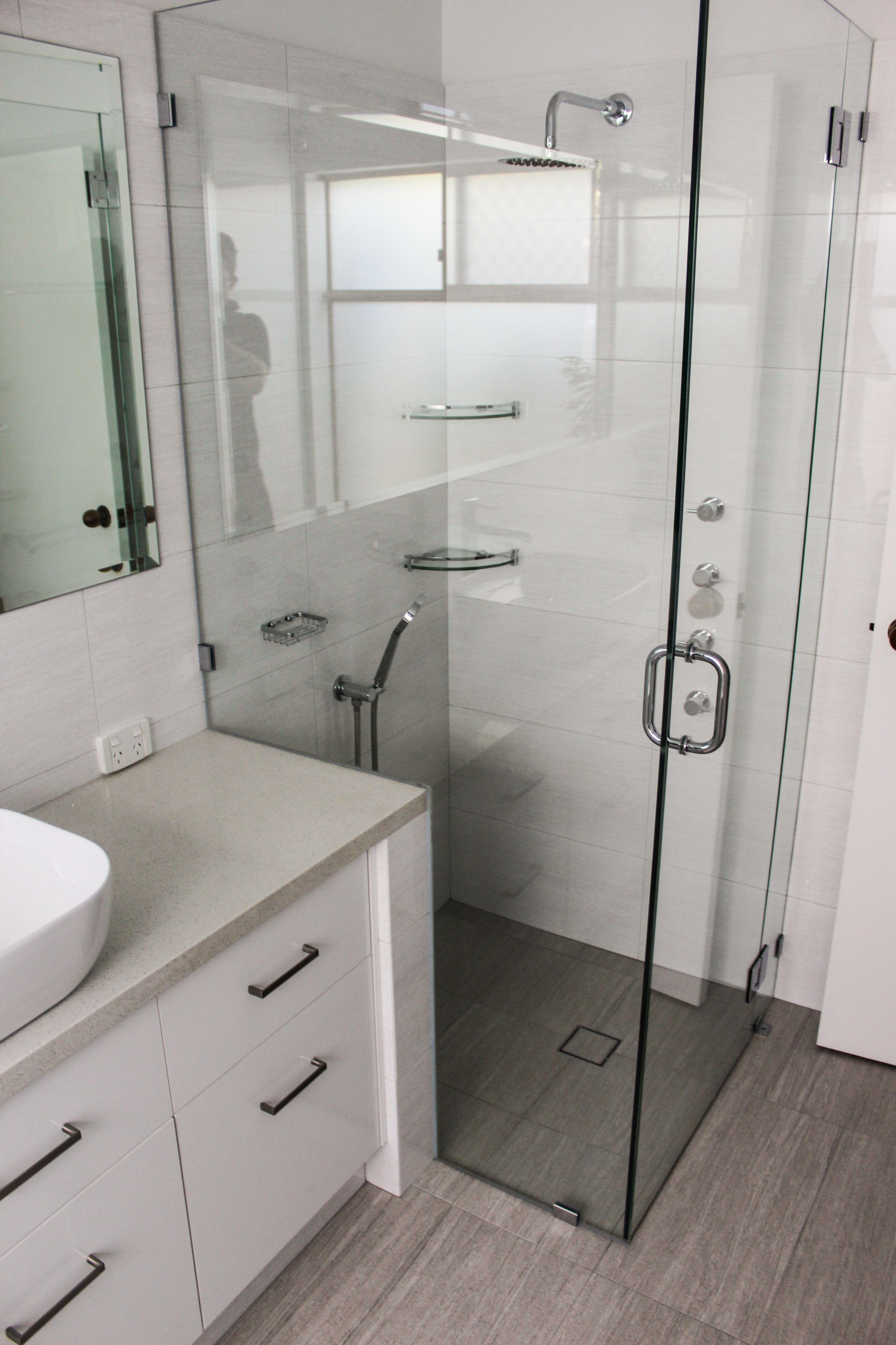 Frameless Shower Screen Pivot Shower Screen On The Ball Bathrooms Grey Bathrooms Tr Bathroom Renovations Perth Bathroom Renovation Trends Shower Screen