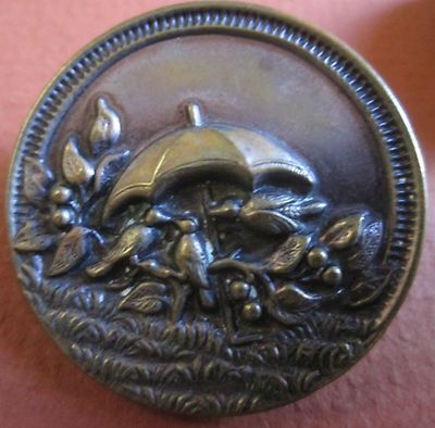Lovely vintage metal button with 3 birds under an umbrella. So Charming. Photo via Ebay