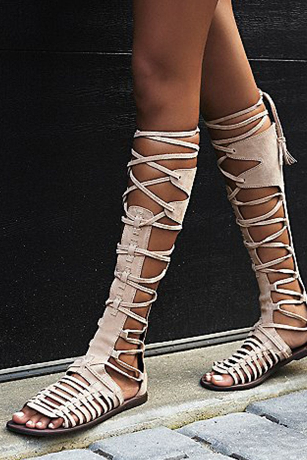 986d7d5926c Tall and strappy suede gladiator sandal with strappy lace-up detailing up  the front. Back zipper closure. Style    OB468831 Material  Suede Color  ...