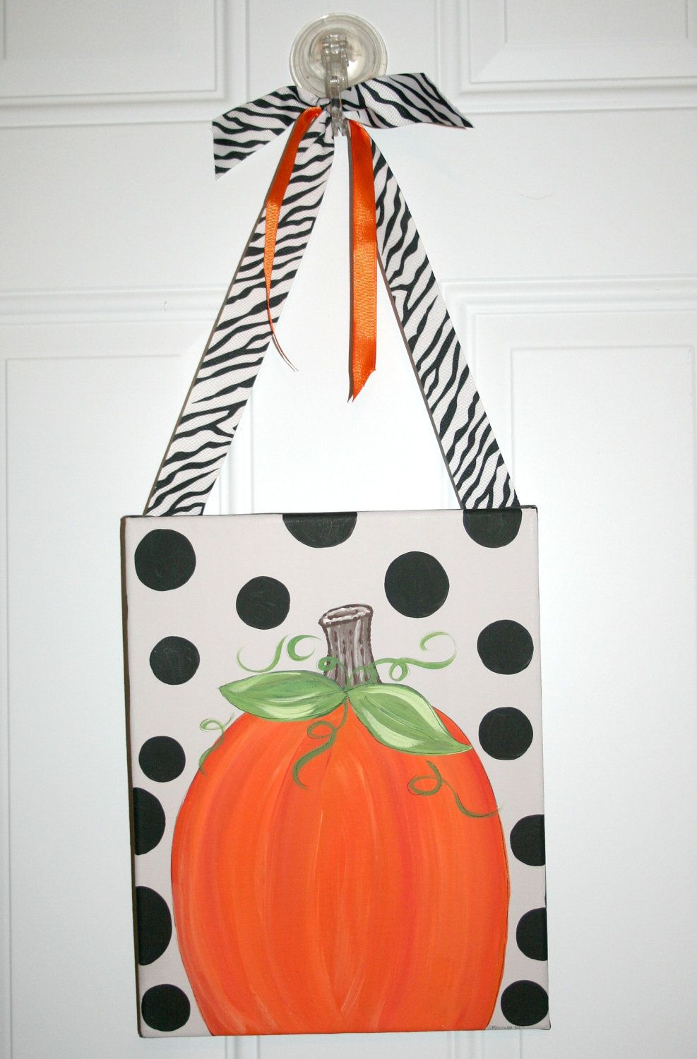Personalized Autumn Pumpkin Fall Canvas Painting Art Decor Hand Painted Door Hanger. $29.99, via Etsy.