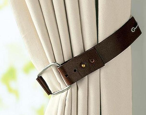 Un cincho viejo pude ser un sujetador para las cortinas es creativo y se convierte en un elemento de la decoración.