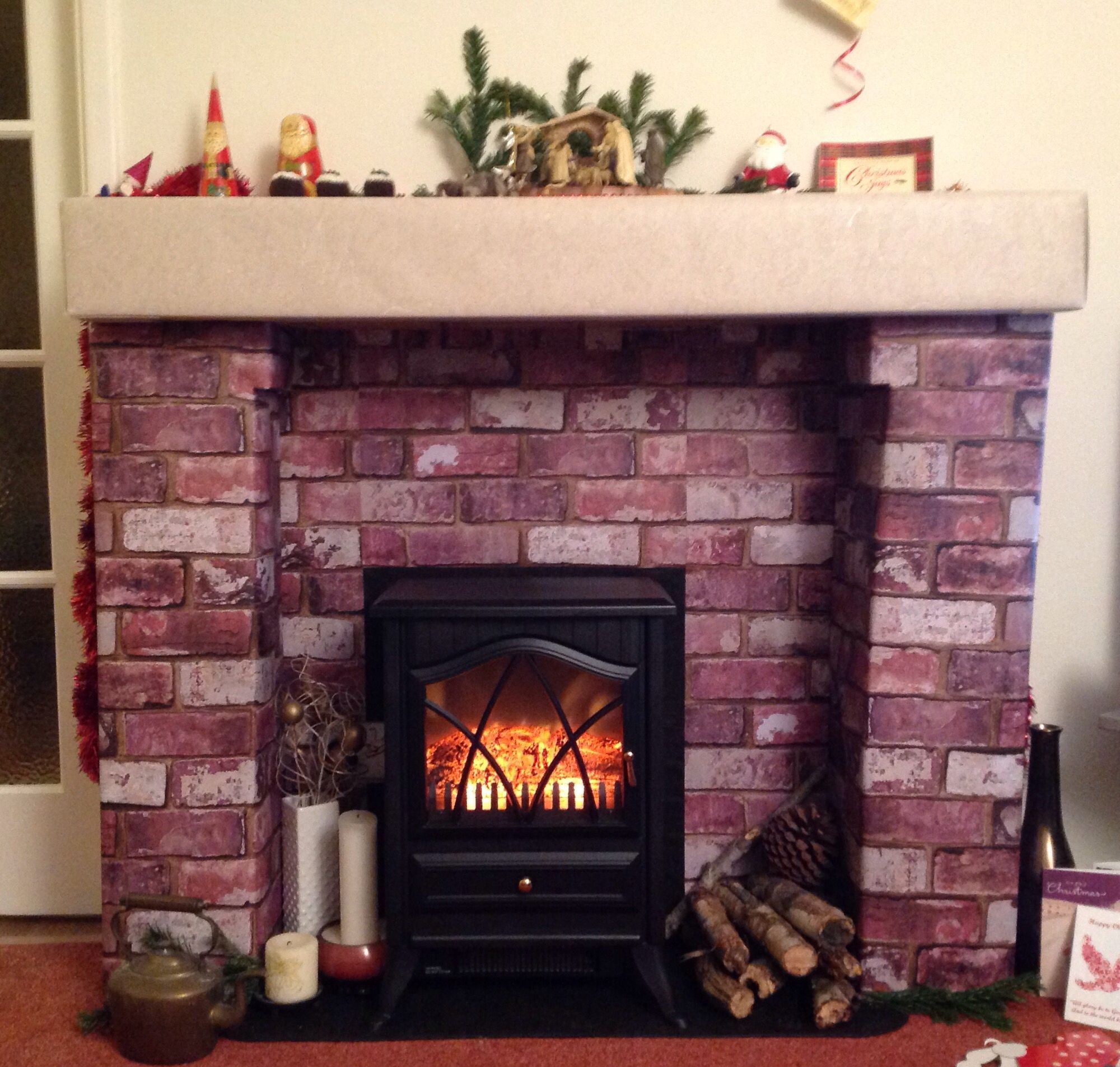 fake fireplace for christmas made from cardboard boxes and