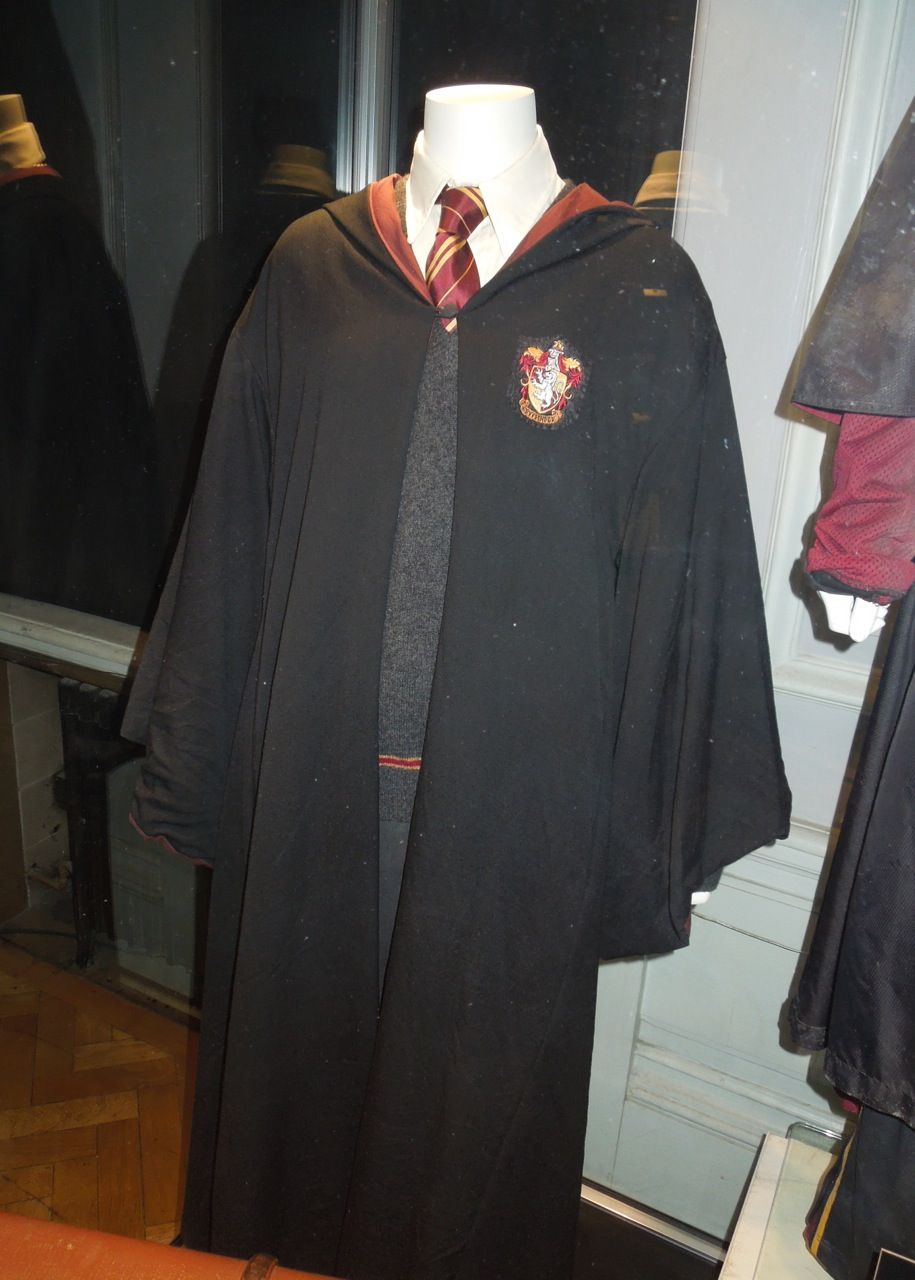 d8e200b954 Harry Potter Hogwarts Gryffindor school uniform. My dad's college  graduation robe, a Gryffindor scarf I had my sister knit for me, and my  sweater with a ...