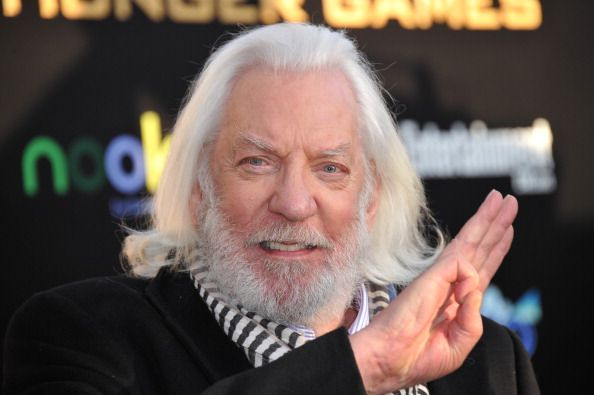 President Snow gives the 3 finger salute? Maybe hes changed.