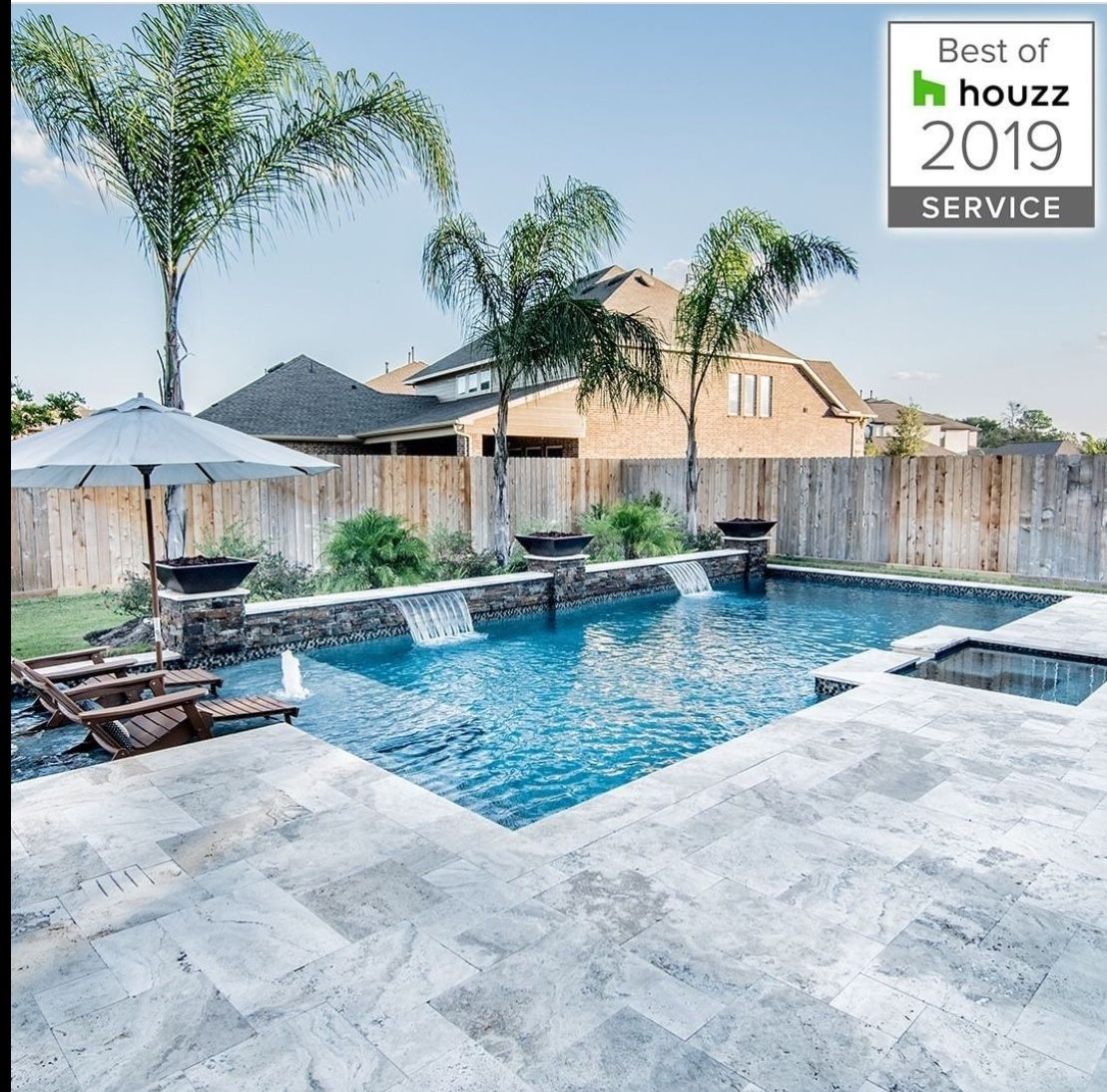 LOVE the grey Travertine, pool color and Palm Trees!!!  Pools