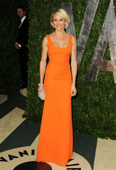Love the bright orange Victoria Beckham gown paired with a silver clutch