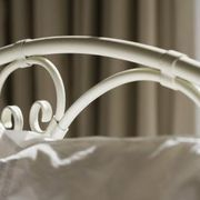 How To Attach A Wrought Iron Headboard To A Bed Frame Ehow Iron Headboard Wrought Iron Headboard Metal Headboard