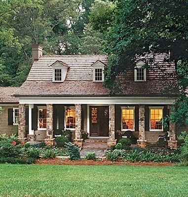 Great Style Home Stone Columns Dormer Windows Long Porch And Simple Landscaping With Images House Exterior Cottage Style Homes Exterior Renovation