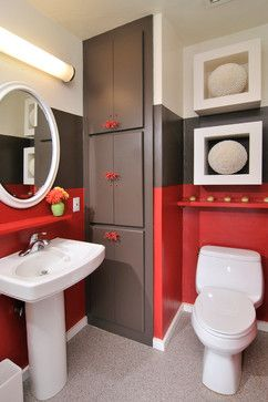 Except for the wash basin and the mirror- we fell in love with this small cute bath- largely because of its bold color combination and also because of the small cute touches like the cabinet handles and the niches above the WC