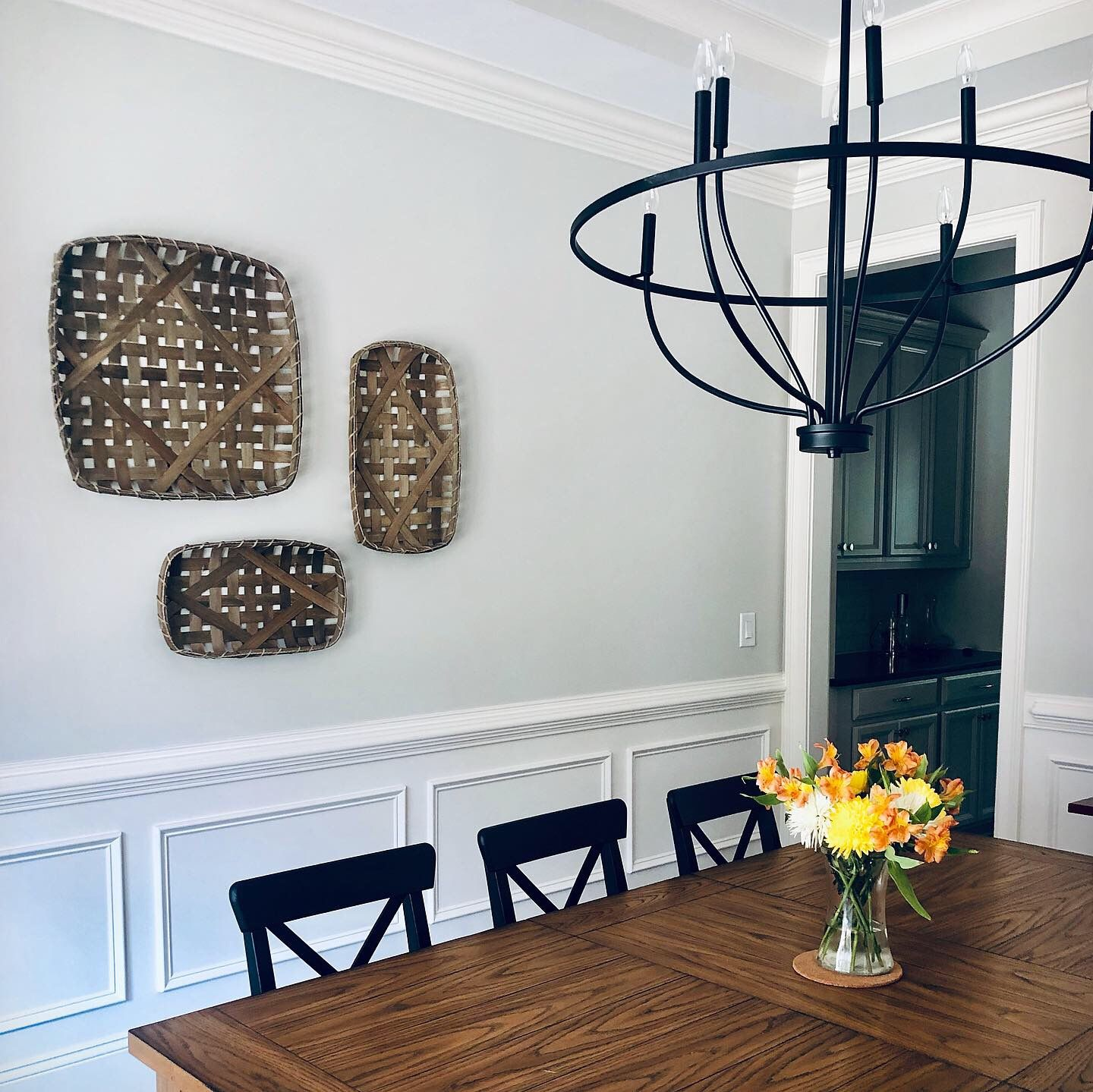 Farmhouse dining room with tobacco basket wall decor