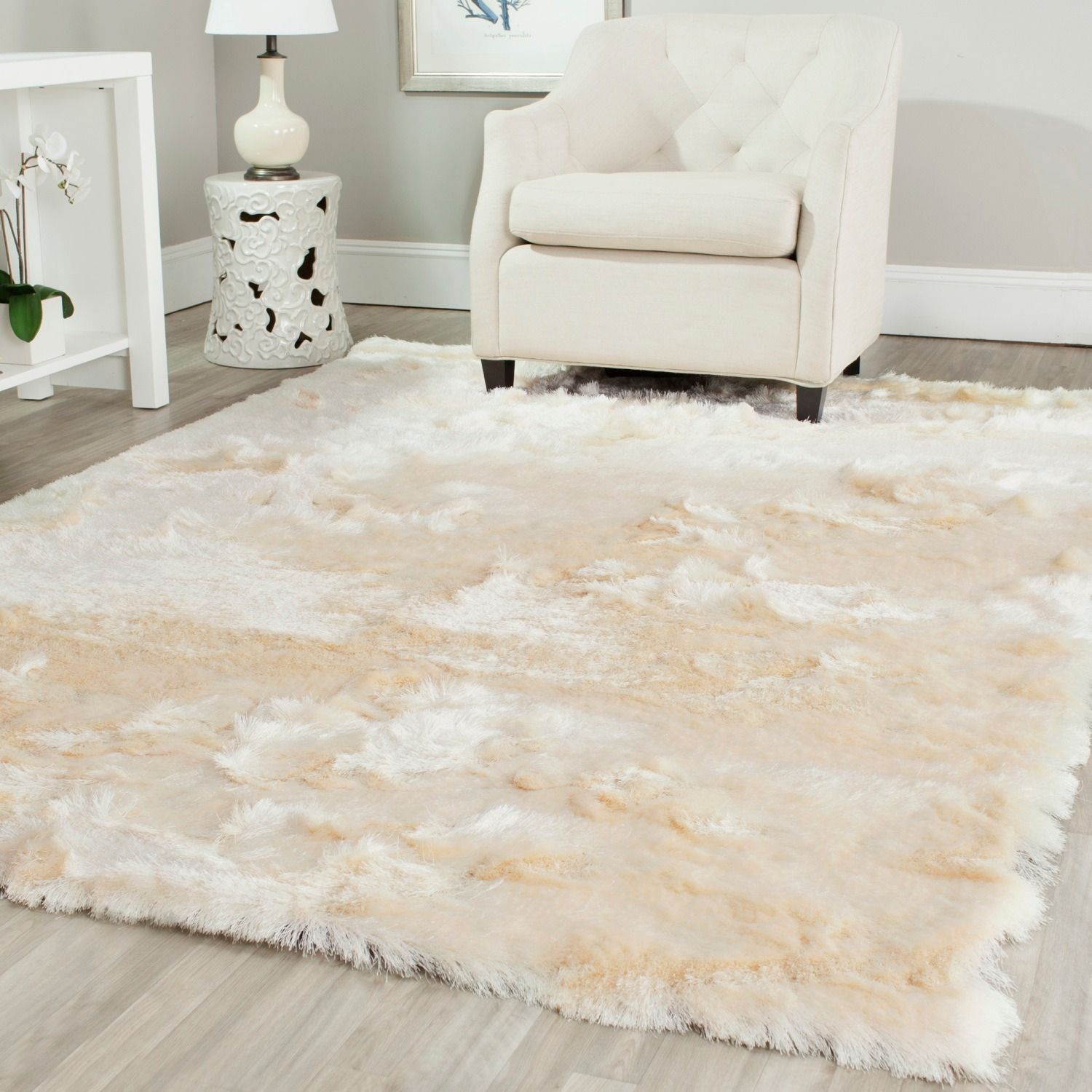 Luxurious deep silky soft pile makes this casual ivory shag rug