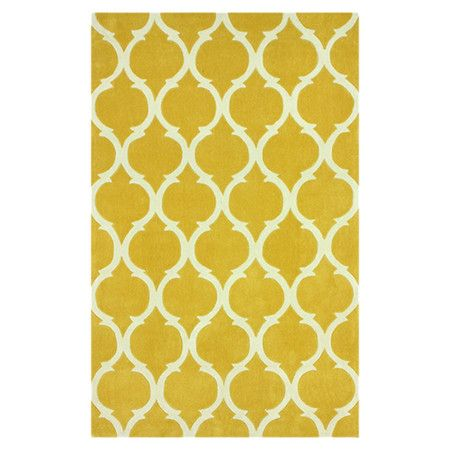 Anchor your dining room or define an area in the den with this chic rug, showcasing a lovely gold-hued trellis motif.   Product: