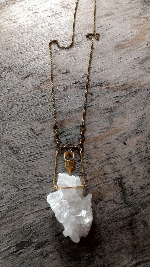 Large quartz crystal wire wrapped necklace $53.00 USD Only 1 available Wire wrapped with a brass point charm hanging from the top. Hangs long on a brass chain.