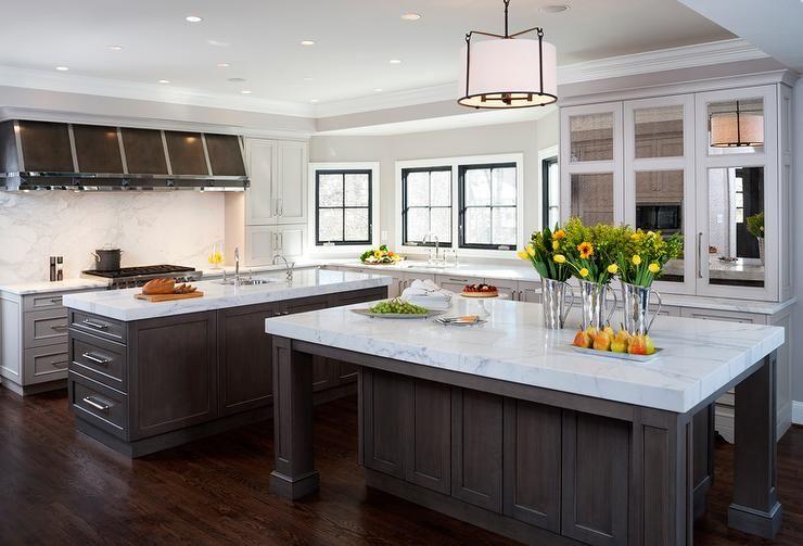 Gourmet kitchen features a white drum pendant with iron trim ...