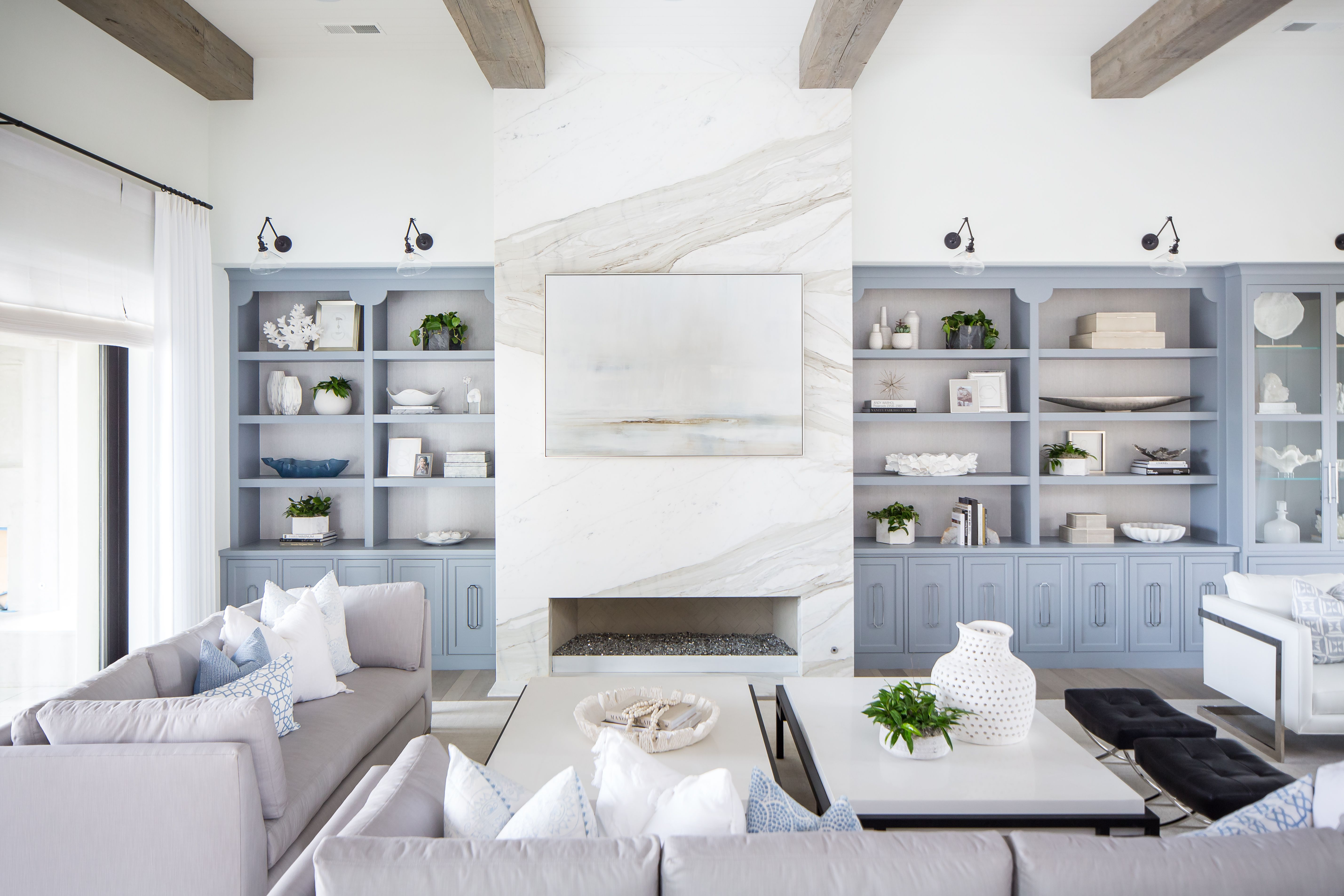 Coastal Living Room With Light Blue Cabinetry And Marble Firep