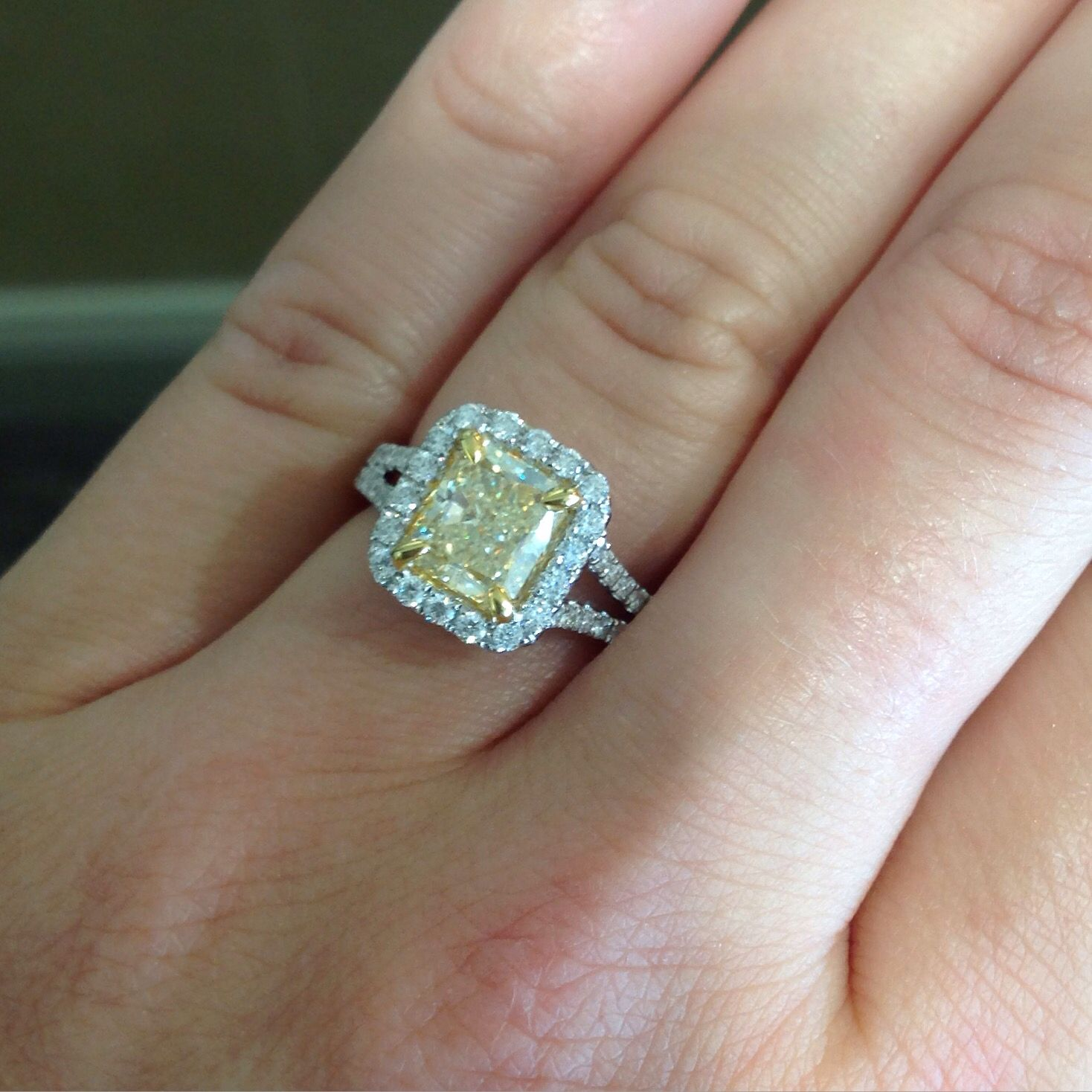 This 2 carat canary yellow cushion cut diamond ring is a stunner