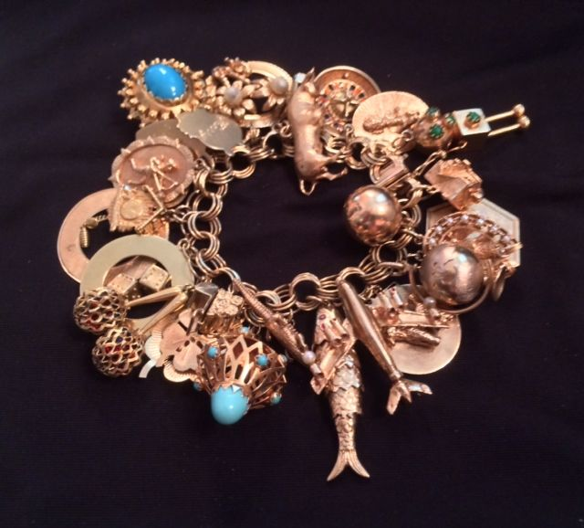 Vintage gold charm bracelet with 30 charms