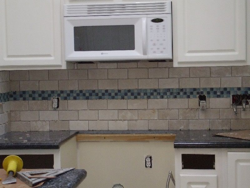 kitchen backsplash white subway tile with blue accent