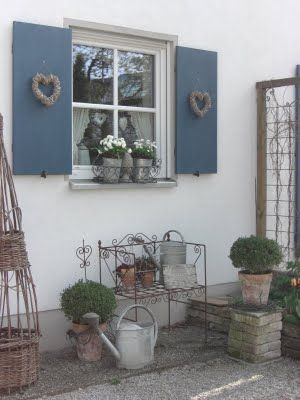 Paint the shutters and put outside?