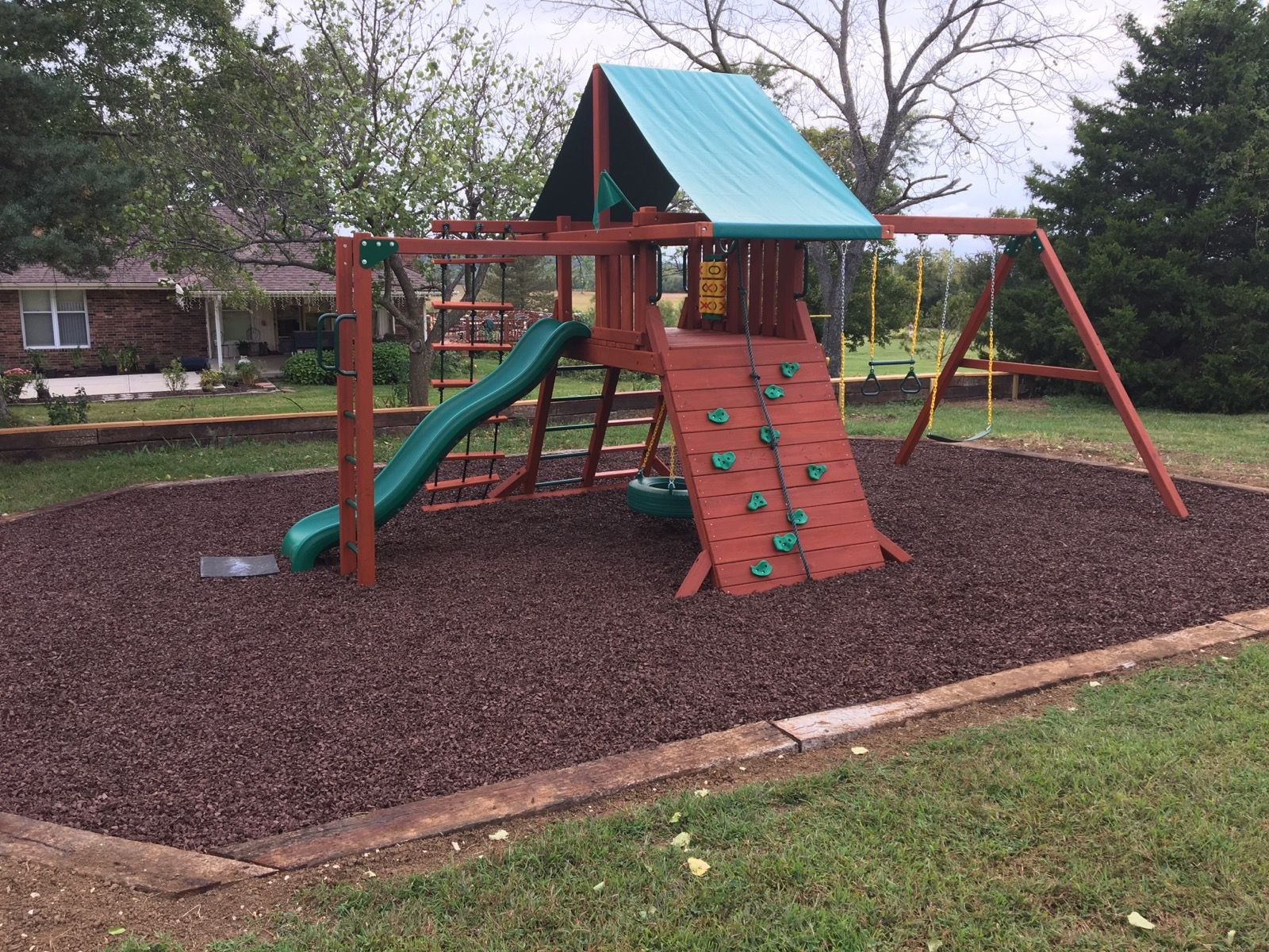 Back yard playground with our premium rubber mulch