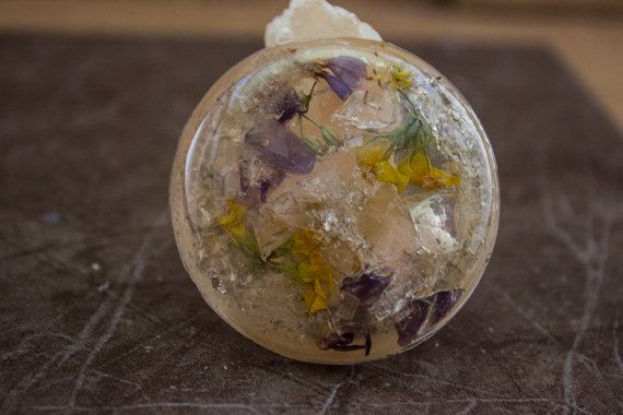 Resin pendant with quartz crystal, amethyst and flowers.  One of a kind,unique item  Size: 3 cm x 3 cm  Chain length: 65 cm   Quartz is one of the
