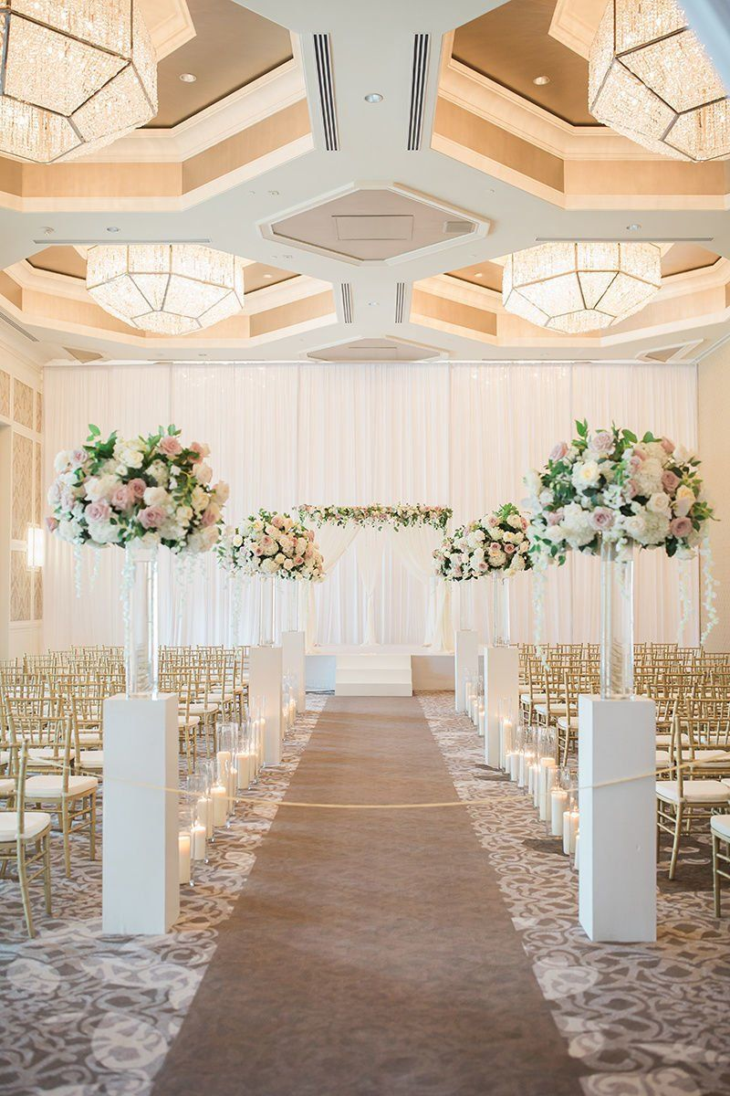Classic wedding ceremony decor idea - tall, pink + white floral ...