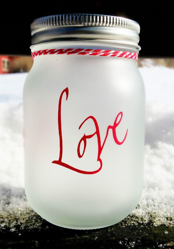 "Love - Frosted Glass Pint Mason Jar Looking for a Valentine's Day gift that will continue to remind your special someone that you love them?  Here it is!  This frosted pint size mason jar has the word ""Love"" in red vinyl on the outside.  Red and white twine is then tied around the neck of the jar.  Add your own LED votive to the inside of the jar to bring a warm glow to any room. #KimsMasonJarCreations #ValentinesDay #Love #masonjars #DIY #weddings #red #frosted #candle #votive #homedecor"