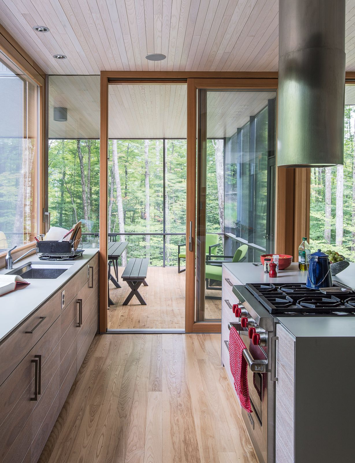 In the kitchen the cabinetry is walnut veneer with a weathered finish applied by cabinetmaker david rogers the process involved sanding and rubbing in
