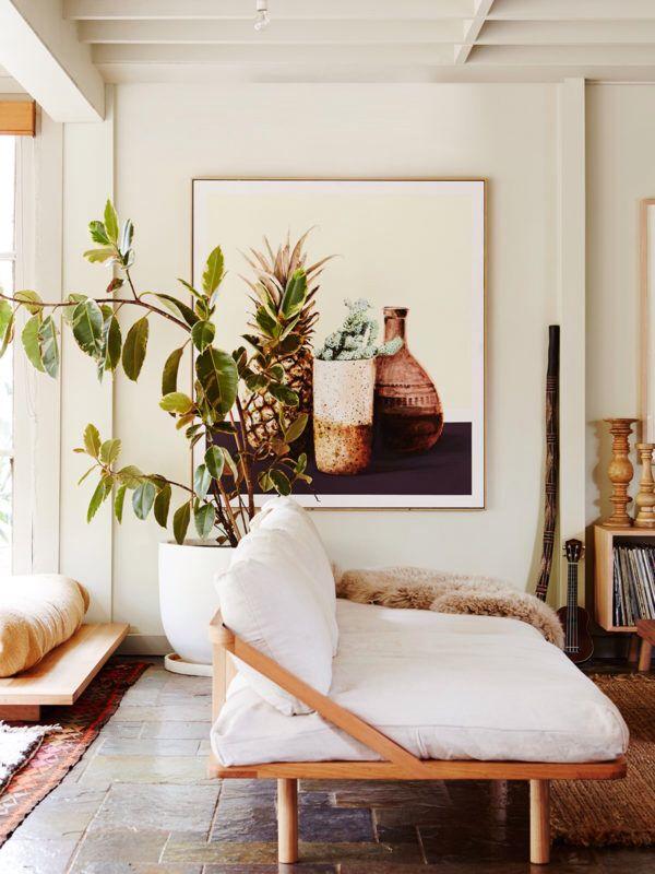 living room | futon sofa | neutrals | neutral color palette | large house plants | large scale art work | interiores | sala de estar | interior design | interior decor