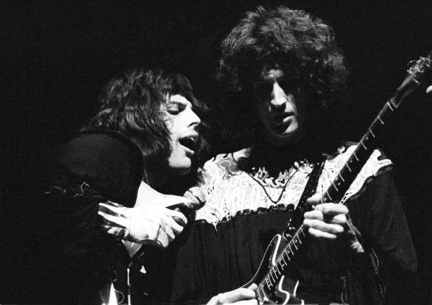 Photo of QUEEN and Freddie MERCURY and Brian MAY; Freddie Mercury and Brian May performing live on stage  (Photo by Ian Dickson)
