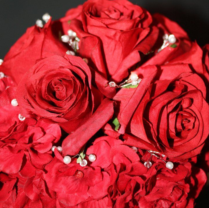 Handmade bouquet made with red roses with pearls and crystals throughout.  Stem was wrapped in gold ribbon.