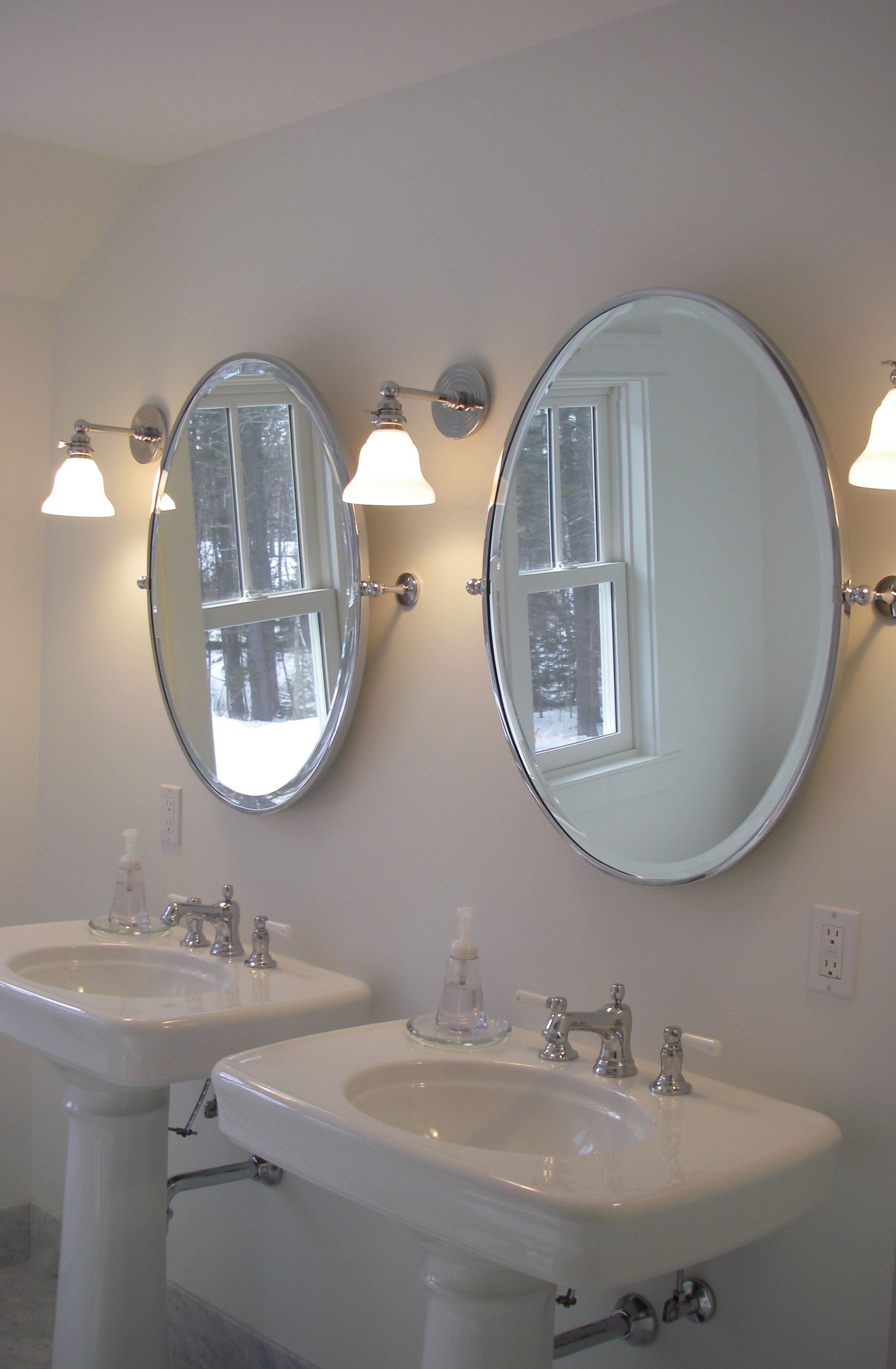 Visual Comfort's Boston Functional single bath sconce is the perfect fixture for this classic bathroom.  Mid-Coast Maine Home