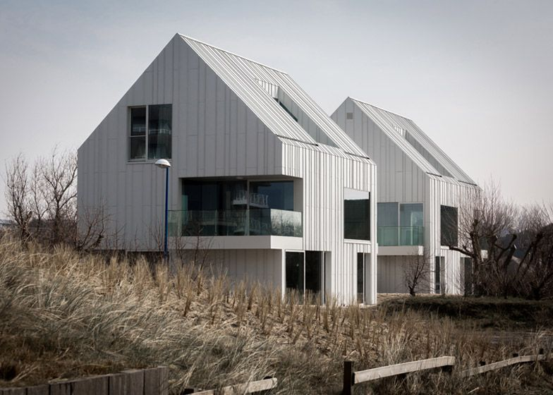 White aluminium panels joined by standing seams create a ridged ...