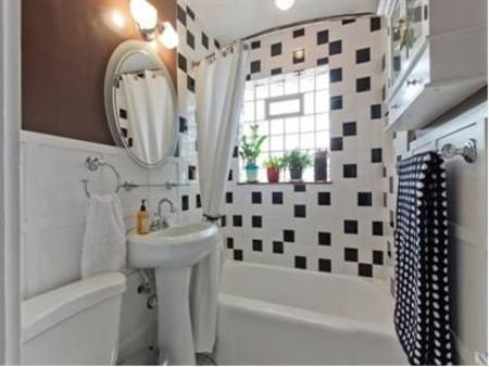 glass block window in shower tile wall and plants vent