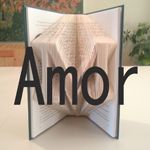 If you've ever seen books with the pages folded into the shape of words and wondered how the heck it's done, here is one method. I've seen methods that use prec
