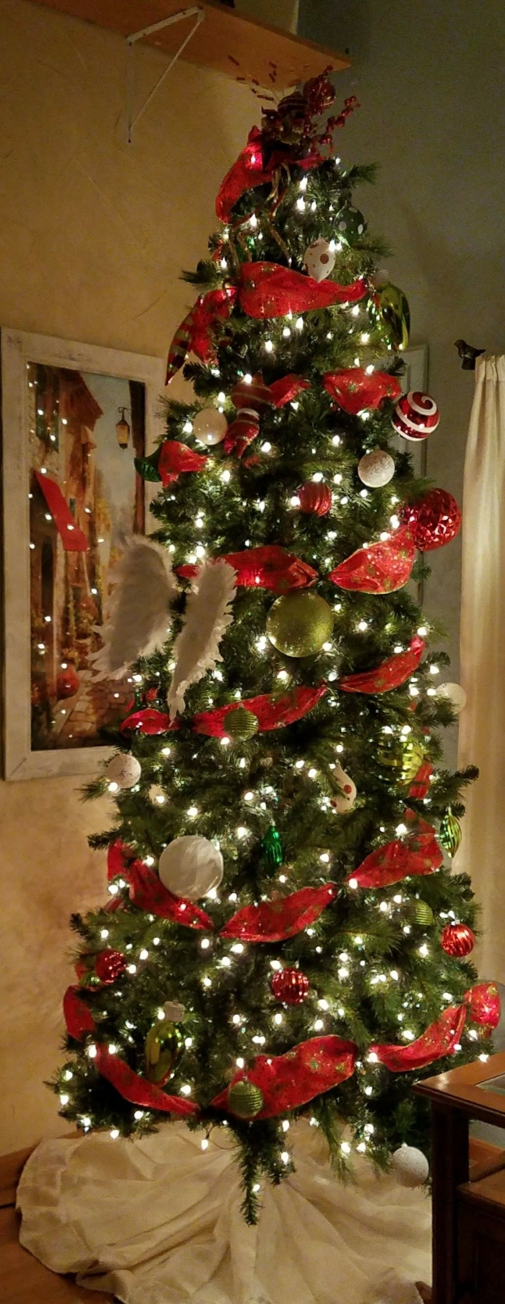 Traditional Christmas Tree With White Lights And Red Ribbon
