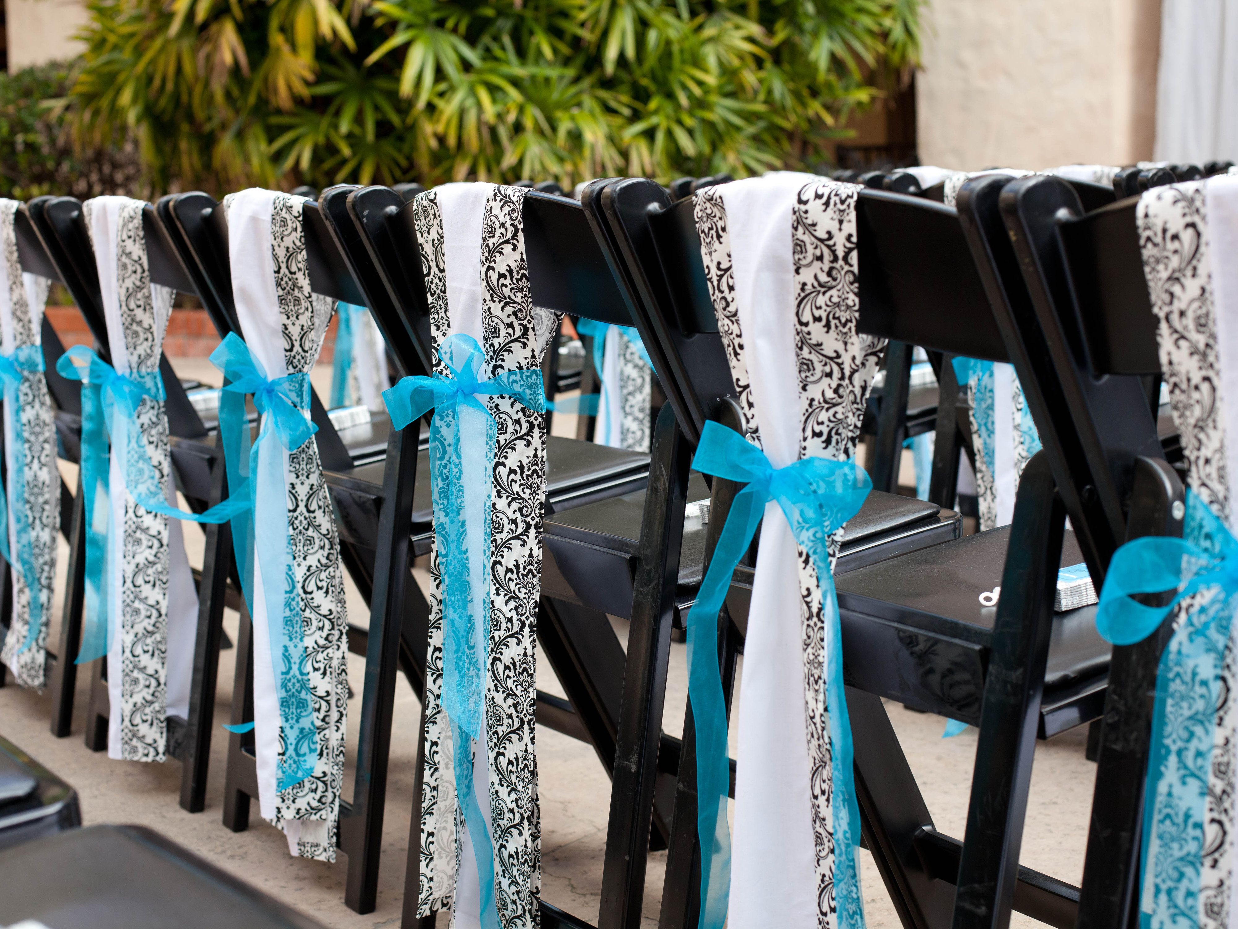 turquoise, black and white wedding chair idea. | wedding chair