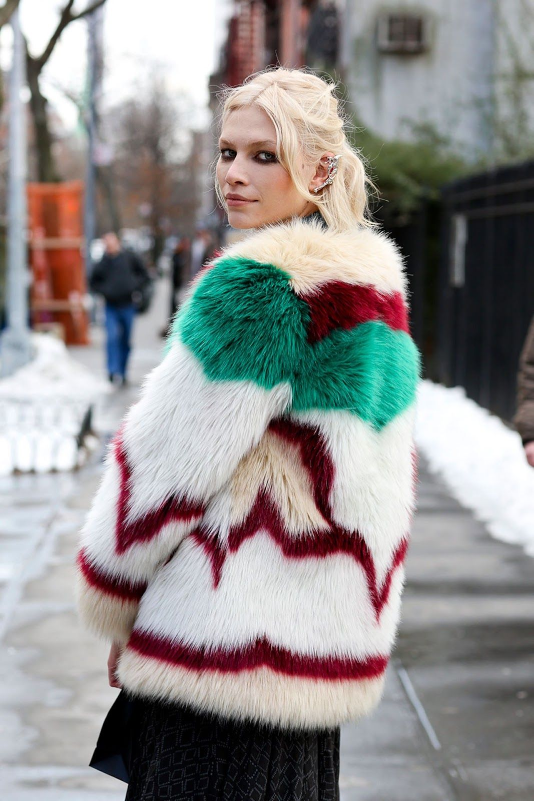Aline Weber wearing an amazing colorful  fur coat.