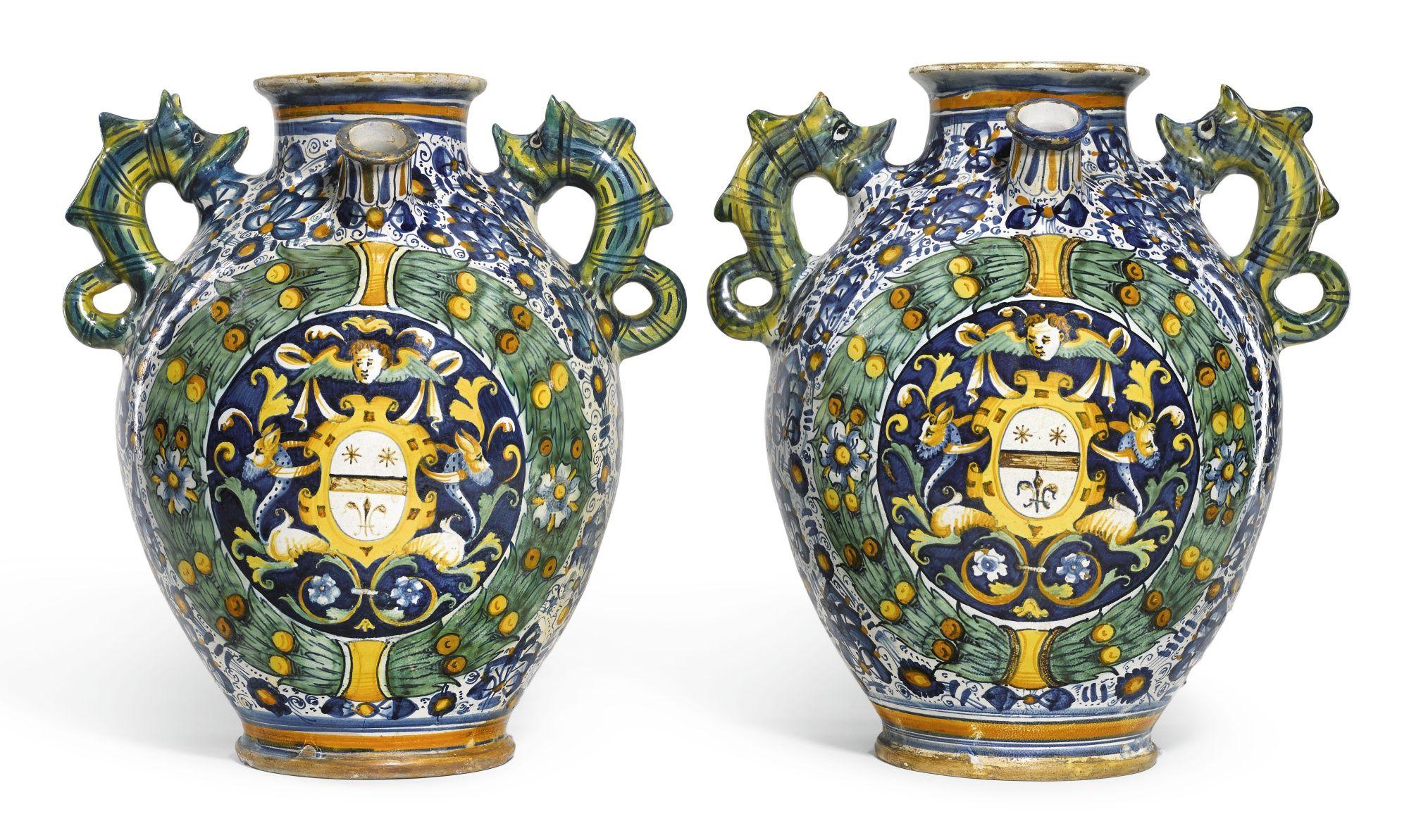 Ceramiche Toscane Montelupo Fiorentino a pair of italian maiolica armorial wet drug jars, montelupo