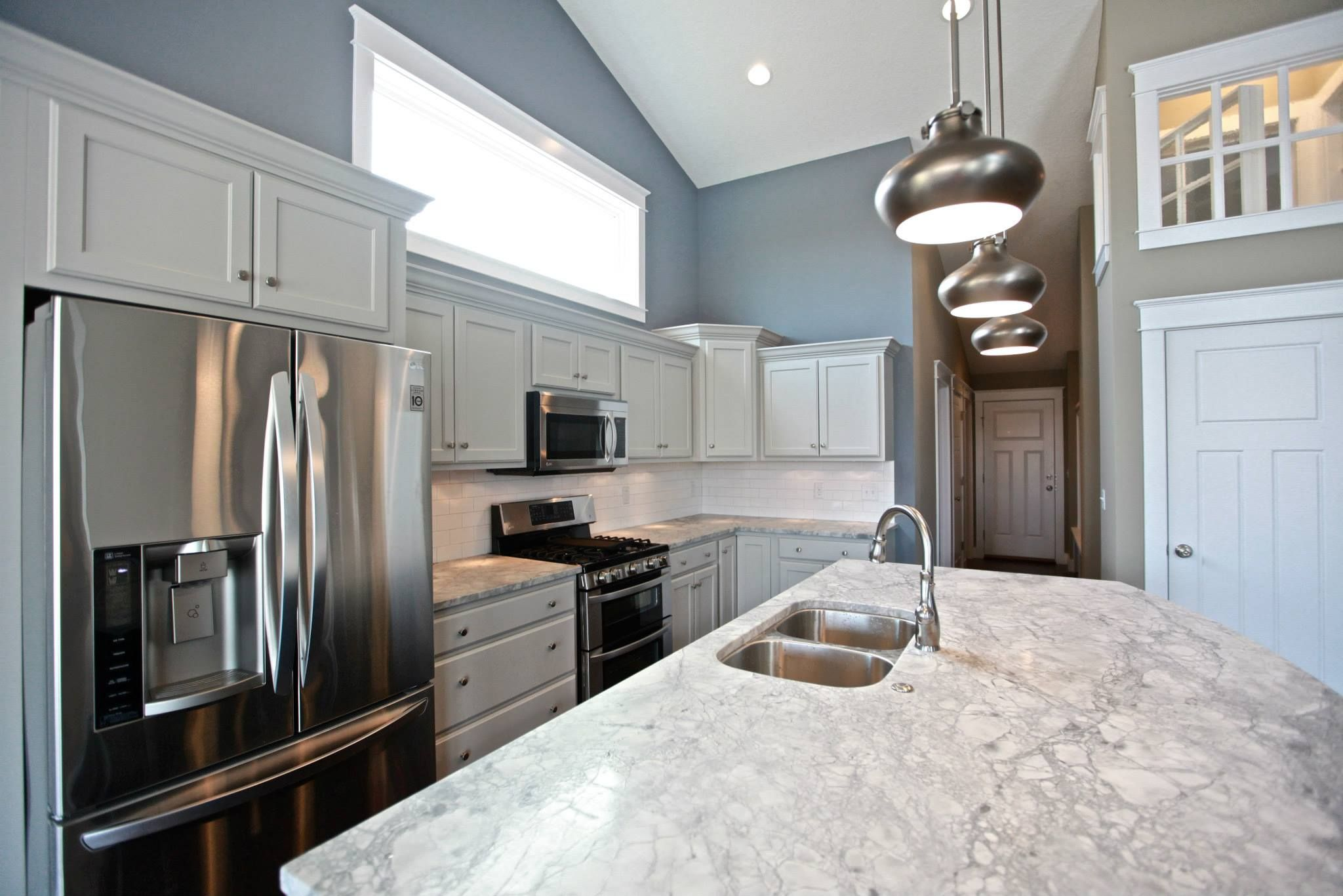 A Gray Painted Kitchen Can Be Subtle Like This Beautiful Oyster Finished Example At A Applestone Homes Pro Kitchen Cabinets Reviews Kitchen Remodel Kitchen
