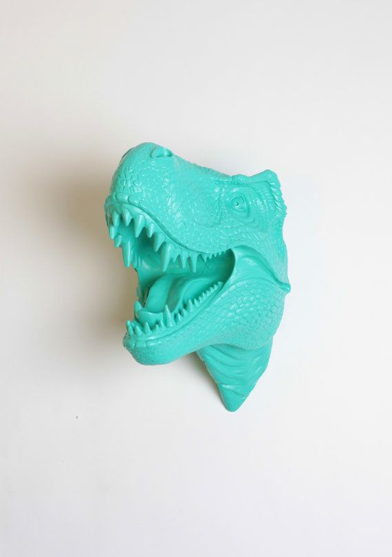Dinosaur Head Wall Mount  The Crowley Turquoise Resin TRex Wall Decor  Trex Dinosaur Decor by White Faux Taxidermy Jurassic Bedroom is part of Chic bedroom Art - The Crowley, our turquoise resin trex head, is custom painted turquoise and can match any style of hanging wall home decor  Don't want him in turquoise  We can customize any of our White Faux Taxidermy pieces to the color of your choice  Simply contact us and we can work together to create your dream faux taxidermy piece! The Crowley Turquoise Faux Dinosaur Wall Mount   The Crowley is not looking directly at you, as his head is turned to his right   Measurements • 14 25  tall • 13 5  wide • 14  deep Weight • About 7lbs total • Each trex mount is cast out of a polyresin material, thus making the dinosaur sculpture fairly light in weight  Hanging Instructions • Use a monkey hook, strong nail or screw More Information • Each trex mount is custom painted so each one is a unique piece of wall hanging decor  • The colors presented are representational only and should not be used to judge actual sculpture color 100%  Before You Purchase • Please ensure that you have reviewed our shop policies for current lead times, shipping information and answers to miscellaneous questions  We thank you in advance for your business   Authentic White Faux Taxidermy Brand sculpture   Exclusively Sold By White Faux Taxidermy