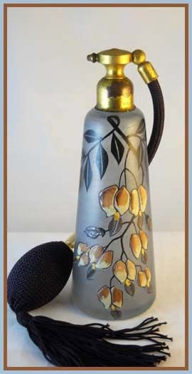 Vintage made in France Atomizer. The theme used is a cascade of enameled flowers trailing down the front of the bottle, mingled with vines.