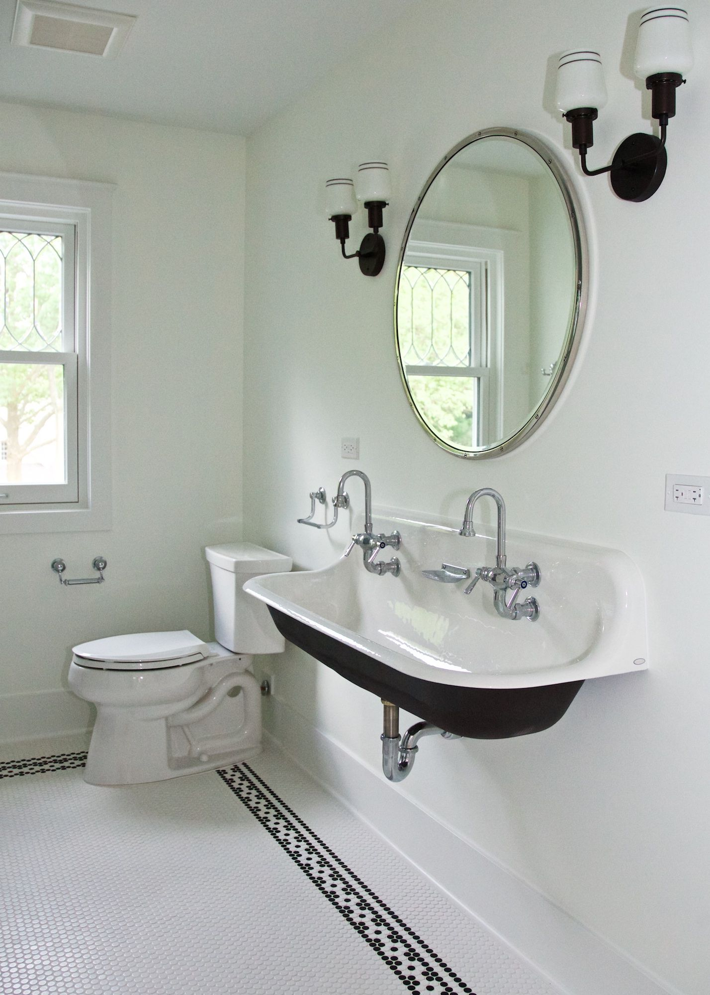 Vintage Inspired Bathroom With Trough Sink And Circle Mirror
