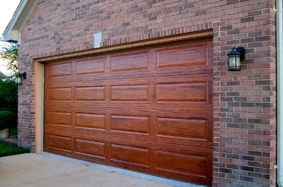 After faux painting how to paint your boring metal garage for Steel garage doors that look like wood