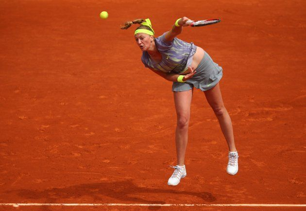 PARIS, FRANCE - MAY 29: Petra Kvitova of Czech Republic serves in her Womens Singles match against Aravane Rezai of France during day four of the French Open at Roland Garros on May 29, 2013 in Paris, France. (Photo by Julian Finney/Getty Images)
